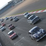 Jaguar of Peter Burton heads the Touring Greats start