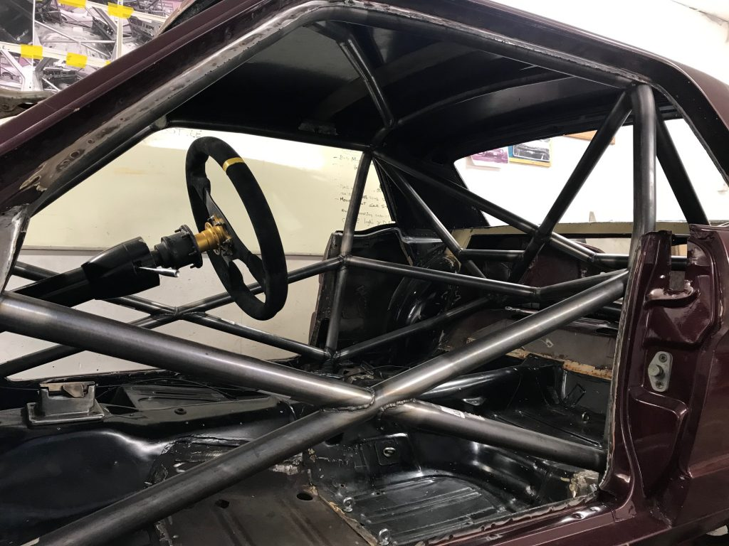 FIA Mustang race preparation and roll cage fitment